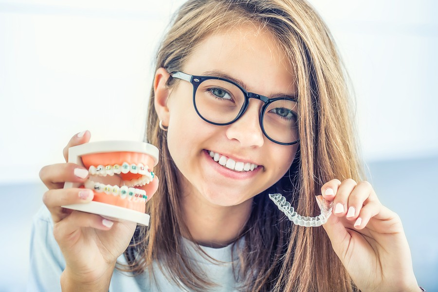 Orthodontist in South Jordan, UT:  How Invisalign Differs From Metal Braces